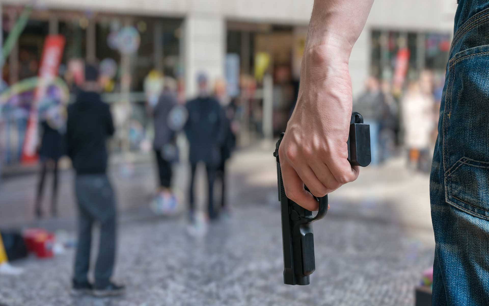 Man using a gun in a public place